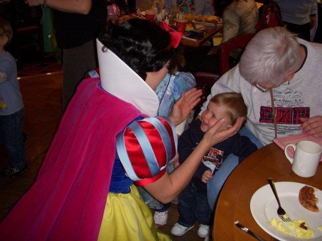 My nephew getting his first kiss from Snow White